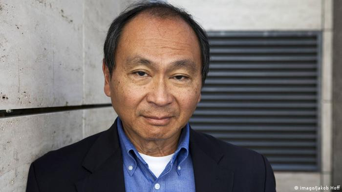 Francis Fukuyama in a professional photograph taken outside a building