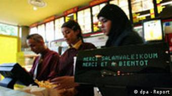 A Muslim restaurant in Clichy-sous-Bois near Paris, where employees are able to keep their veil, and customers eat halal burger