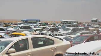 Refugees wait in traffic to get into Erbil