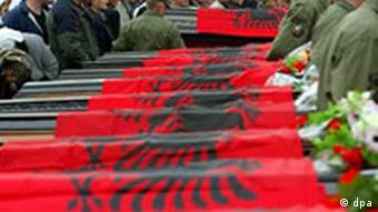 Caskets draped with the Kosovo Albanian flag