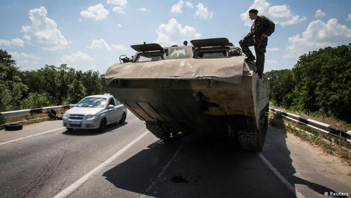 Pro-Russian separatists on a tank