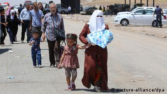 A woman and child on their way into Erbil