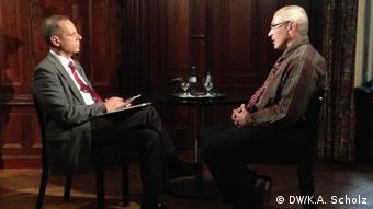Mikhail Kodorkovski sits across from his interviewer