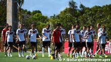 Germany's coach Joachim Loew (C) oversees a training session of Germany's national football team in Santo Andre on June 11, 2014 ahead of the 2014 FIFA World Cup football tournament. AFP PHOTO / PATRIK STOLLARZ (Photo credit should read PATRIK STOLLARZ/AFP/Getty Images)