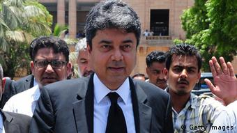 Farogh Naseem (C), barrister and counsel for former Pakistani military ruler Pervez Musharraf, leaves the high court after a hearing in Karachi on June 12, 2014 (Photo: ASIF HASSAN/AFP/Getty Images)