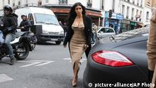 Kim Kardashian arrives at a luxury shop in Paris, Wednesday, May 21, 2014. The gates of the Chateau de Versailles, once the digs of Louis XIV, will be thrown open to Kim Kardashian, Kanye West and their guests for a private evening this week ahead of their marriage (AP Photo/Jacques Brinon)