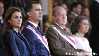 Spain's royal family sitting alongside one another