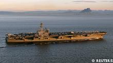 The aircraft carrier USS George H. W. Bush transits the Strait of Gibraltar into the Mediterranean Sea in this February 27, 2014 picture provided by the U.S. Navy. U.S. Defense Secretary Chuck Hagel ordered the aircraft carrier USS George H. W. Bush moved into the Gulf on Saturday, readying it in case Washington decides to pursue a military option after insurgents overwhelmed a string of Iraqi cities this week and threatened Baghdad. REUTERS/U.S. Navy/Lt. Juan David Guerra/Handout via Reuters (SPAIN - Tags: MILITARY MARITIME) ATTENTION EDITORS - THIS IMAGE WAS PROVIDED BY A THIRD PARTY. FOR EDITORIAL USE ONLY. NOT FOR SALE FOR MARKETING OR ADVERTISING CAMPAIGNS. THIS PICTURE IS DISTRIBUTED EXACTLY AS RECEIVED BY REUTERS, AS A SERVICE TO CLIENTS