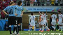 Uruguay's forward Diego Forlan (L) and Uruguay's forward Edinson Cavani (2nd L) look on as Costa Rica's players celebrate after scoring during a Group D football match between Uruguay and Costa Rica at the Castelao Stadium in Fortaleza during the 2014 FIFA World Cup on June 14, 2014. AFP PHOTO / GABRIEL BOUYS (Photo credit should read GABRIEL BOUYS/AFP/Getty Images)
