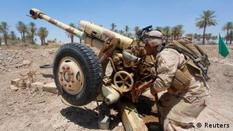 Iraqi army troops fighting ISIS militants Photo: REUTERS/Alaa Al-Marjani