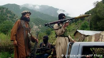 Pakistani Taliban patrol in their stronghold of Shawal in Pakistani tribal region of South Waziristan (AP Photo/Ishtiaq Mahsud, File)