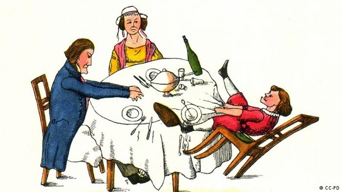 A boy at the dinner table with his parents,Copyright: CC-PD