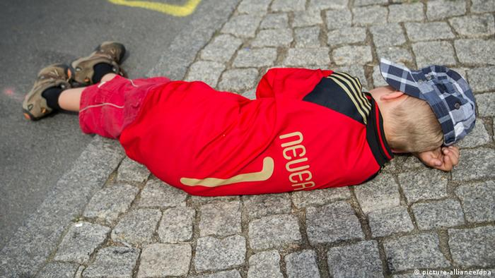 A child lies down sleeping during World Cup celebrations
