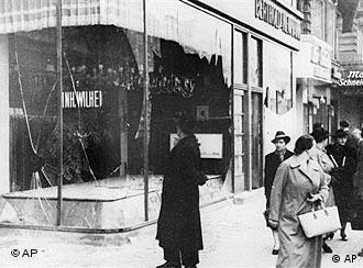 A pedestrian looks at the wreckage of a Jewish shop in Berlin, Nov. 10, 1938, the day after the Kristallnacht rampage, when Nazi thugs set fire to hundreds of synagogues, looted thousands of Jewish businesses and attacked Jews in Germany and Austria.