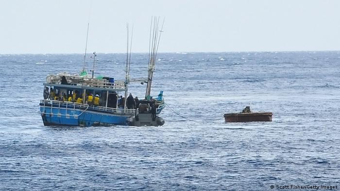 Suspected asylum seekers after being intercepted and escorted in by the Australian Navy. (Photo by Scott Fisher/Getty Images)