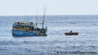 Suspected asylum seekers arrive at to Flying Fish Cove, Christmas Island, after being intercepted and escorted in by the Australian Navy, on August 3, 2013 near Christmas Island, In