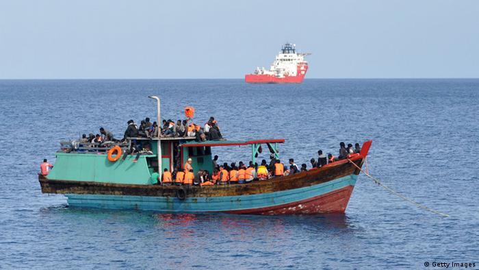 Suspected asylum seekers arrive at Christmas Island, after receiving assistance by Australian Navy, on October 13, 2012 on Christmas Island.