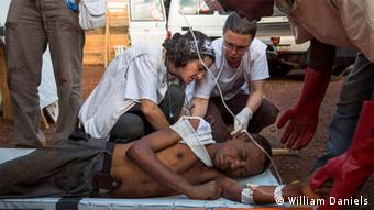 MSF doctors treat a wounded man