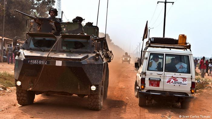An MSF vehicle accompanied by armed soldiers in Central African Republic