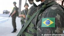 Soldiers stand in front of the entrance of the airport in Porto Seguro, Brazil, 07 June 2014. The FIFA World Cup will take place in Brazil from 12 June to 13 July 2014. Photo: Marcus Brandt/dpa +++(c) dpa - Bildfunk+++