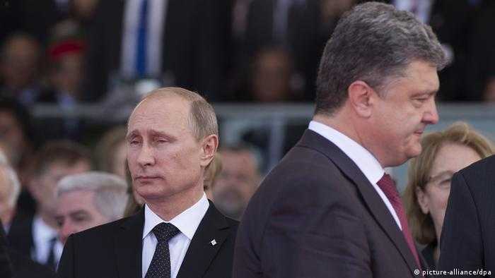 President Vladimir Putin (left) and Ukrainian President-Elect Petro Poroshenko during the celebrations of the 70th anniversary of the allied landing in Normandy. Aleksey Nikolskyi/RIA Novosti