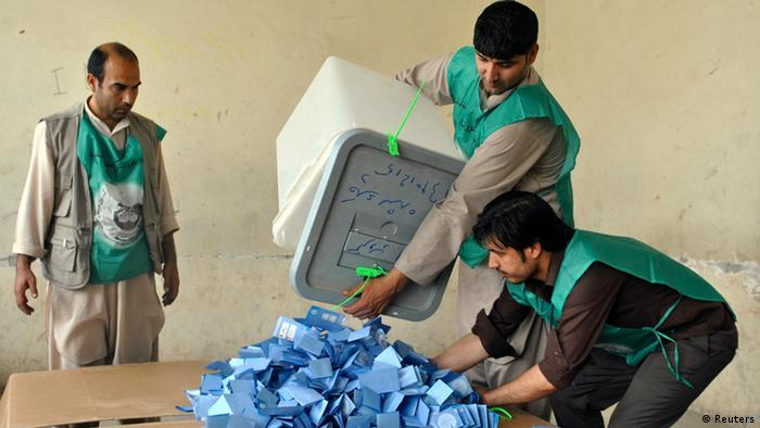 Afghan election workers prepare to start counting ballot papers after voting closed at a polling station in Mazar-I-Shariff June 14, 2014.