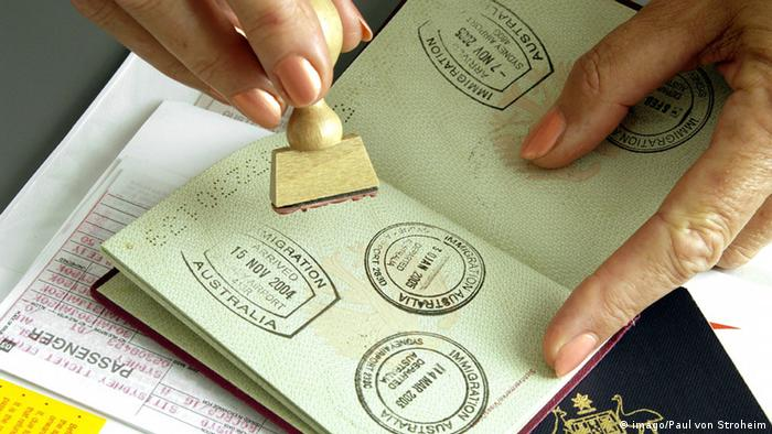 A passport being stamped