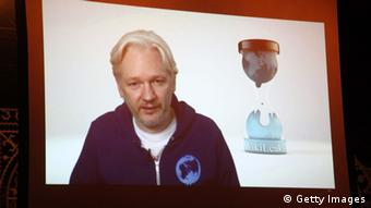 Julian Assange on screen, Copyright: Getty Images