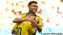 epa04267368 Colombia's Juan Quintero (L) celebrates his 2-0 goal with team mate Teofilo Gutierrez (R) during the FIFA World Cup 2014 group C preliminary round match between Colombia and the Ivory Coast at the Estadio Nacional in Brasilia, Brazil, 19 June 2014. (RESTRICTIONS APPLY: Editorial Use Only, not used in association with any commercial entity - Images must not be used in any form of alert service or push service of any kind including via mobile alert services, downloads to mobile devices or MMS messaging - Images must appear as still images and must not emulate match action video footage - No alteration is made to, and no text or image is superimposed over, any published image which: (a) intentionally obscures or removes a sponsor identification image; or (b) adds or overlays the commercial identification of any third party which is not officially associated with the FIFA World Cup) EPA/SHAWN THEW EDITORIAL USE ONLY +++(c) dpa - Bildfunk+++