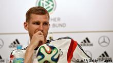 Germany's defender Per Mertesacker looks on during a press conference in Santo Andre on June 19, 2014 as part of the FIFA 2014 World Cup in Brazil. AFP PHOTO/ PATRIK STOLLARZ (Photo credit should read PATRIK STOLLARZ/AFP/Getty Images)