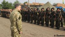 Ukraine's President Petro Poroshenko greets servicemen at the military camp near the town of Svyatogorsk in Eastern Ukraine, June 20, 2014. Poroshenko on Friday announced a week-long ceasefire in the fight against pro-Russian separatists in the east of the country, his website said. REUTERS/Mykhailo Markiv/Ukrainian Presidential Press Service/Handout via Reuters (UKRAINE - Tags: POLITICS CIVIL UNREST MILITARY) ATTENTION EDITORS - THIS PICTURE WAS PROVIDED BY A THIRD PARTY. REUTERS IS UNABLE TO INDEPENDENTLY VERIFY THE AUTHENTICITY, CONTENT, LOCATION OR DATE OF THIS IMAGE. FOR EDITORIAL USE ONLY. NOT FOR SALE FOR MARKETING OR ADVERTISING CAMPAIGNS. THIS PICTURE IS DISTRIBUTED EXACTLY AS RECEIVED BY REUTERS, AS A SERVICE TO CLIENTS
