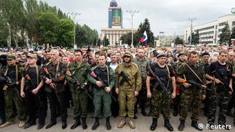 Pro-Russian troops gather in a public square