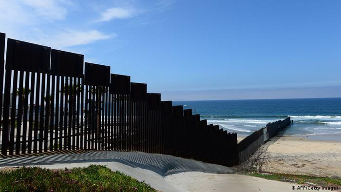 Border fence between US and Mexico, reaching into the ocean (Photo: FREDERIC J. BROWN/AFP/Getty Images)