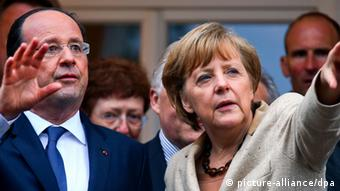 Francois Holland and Angela Merkel