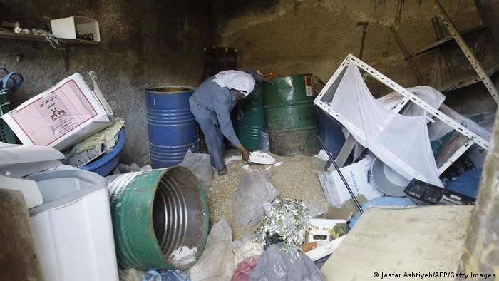 Toppled boxes and debris in a home searched by Israeli security forces