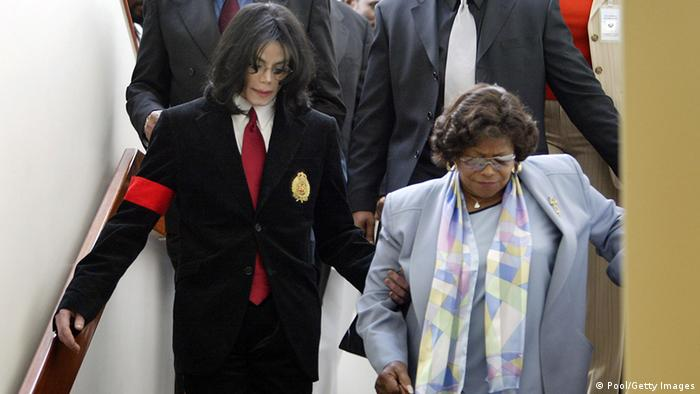Michael Jackson helps his mother Katherine Jackson down the stairs from a courthouse