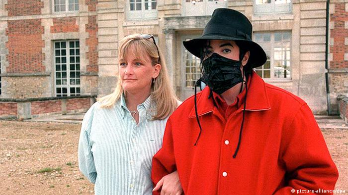 Michael Jackson stands arm in arm with Debbie Rowe