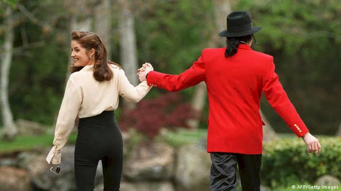 Michael Jackson and Lisa Marie Presley walk hand in hand