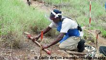 (FILES) A file photo taken on March 2, 2011 shows a worker from a non-governmental organization checking the ground before a demining operation at the Biopio dam in Lobito district. Angola on April 4, 2012 celebrates 10 years of peace after a devastating civil war. The death of Unita rebel leader Jonas Savimbi on February 22, 2002 in a battle in the eastern town of Luena paved the way to a peace deal signed in the capital Luanda on April 4, 2002, ending the 27-year civil conflict that erupted soon after independence from Portugal in 1975. Nearly 2.4 million people, almost a fifth of the population, still live in areas riddled with landmines, according to the International Campaign to Ban Landmines. The conflict left an estimated 500,000 dead and displaced four million others. Roads, bridges, farms and entire towns were destroyed. AFP PHOTO / CECILE DE COMARMOND (Photo credit should read CECILE DE COMARMOND/AFP/Getty Images)