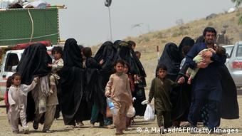Pakistani civilians, fleeing from a military operation in North Waziristan tribal agency, arrive in Saidgai on June 22, 2014 (Photo: A Majeed/AFP/Getty Images)