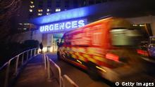 GRENOBLE, FRANCE - DECEMBER 30: An emergency ambulance arrives at the Grenoble Hospital where former German Formula One driver Michael Schumacher is being treated for a severe head injury following a skiing accident on Sunday in Meribel, on December 30, 2013 in Grenoble, France. (Photo by Alex Grimm/Bongarts/Getty Images)