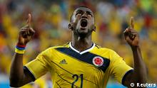 Colombia's Jackson Martinez celebrates after scoring against Japan during their 2014 World Cup Group C soccer match at the Pantanal arena in Cuiaba June 24, 2014. REUTERS/Eric Gaillard (BRAZIL - Tags: TPX IMAGES OF THE DAY SOCCER SPORT WORLD CUP)