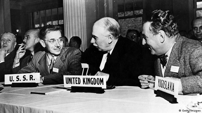 The economist John Maynard Keynes, (1883 - 1946) (C), at the UN International Monetary Conference in 1944.
