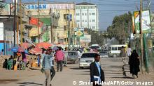 People walk in a street of Hargeisa on October 31, 2012. AFP PHOTO / SIMON MAINA (Photo credit should read SIMON MAINA/AFP/Getty Images)