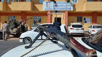 Guards outside a Libyan election polling station 25.6.2014 Photo: REUTERS/Saddam Alrashdy