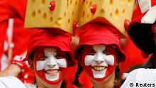 Swiss fans attend the 2014 World Cup Group E soccer match between Switzerland and Honduras at the Amazonia arena in Manaus June 25, 2014. REUTERS/Dominic Ebenbichler (BRAZIL - Tags: SOCCER SPORT WORLD CUP)