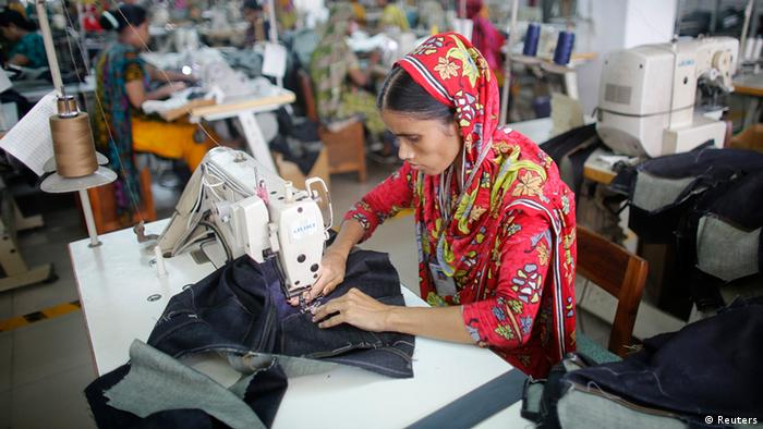 A worker works in a factory of Ananta Garments Ltd in Savar June 10, 2014.