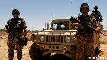 Jordanian soldiers stand guard near the Jordanian Karameh border crossing at the Jordanian-Iraqi border, near Ruweished city, June 25, 2014. REUTERS/Muhammad Hamed (JORDAN - Tags: POLITICS MILITARY CIVIL UNREST)