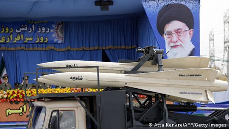 A military truck carrying Shalamcheh missiles drives past the presidential rostrum during the annual Army Day military parade on April 18, 2014 in Tehran