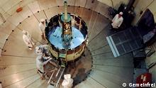 NASA's International Sun-Earth Explorer C (ISEE C) was undergoing testing and evaluation inside Goddard's dynamic test chamber when this photo was taken. Working inside a dynamic test chamber, Goddard engineers wear protective clean room clothing to prevent microscopic dust particles from damaging the sophisticated instrumentation. NASA launched the 16-sided polyhedron, which weighed 1,032 lbs. (469 kg.), from Cape Canaveral, Florida, on August 12, 1978. From its halo orbit 932,000 miles (1.5 million km.) from Earth, the satellite monitored the characteristics of solar phenomena about one hour before its companion satellites-ISEE-A and ISEE-B-observed the same phenomena from a much closer near-Earth orbit. The correlated measurements supported the work of 117 scientific investigators who were trying to get a better understanding of how the Sun controls Earth's near-space environment. The scientists represented 35 universities in 10 nations License details Public domain This file is in the public domain because it was solely created by NASA. NASA copyright policy states that NASA material is not protected by copyright unless noted. (See Template:PD-USGov, NASA copyright policy page or JPL Image Use Policy.)